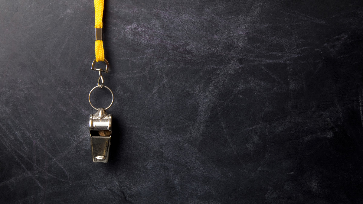 Graphic of a blackboard with a sports whistle hanging in front