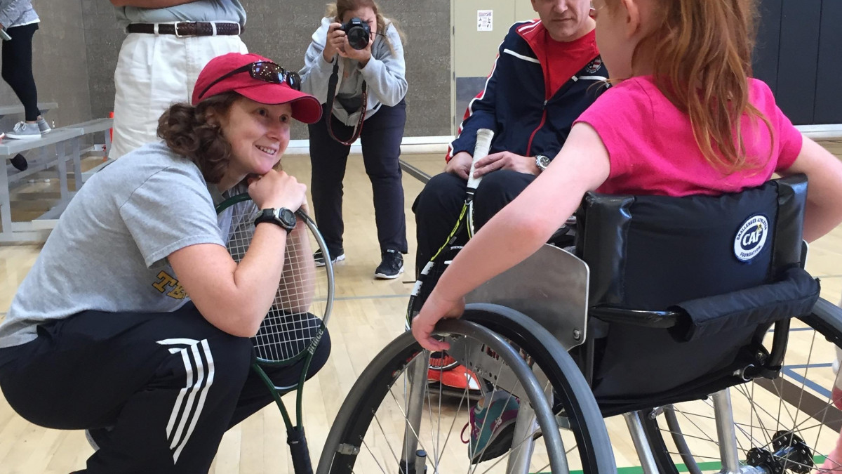 Dr. Erin Andrade coaches wheelchair tennis and treats people with disabilities.
