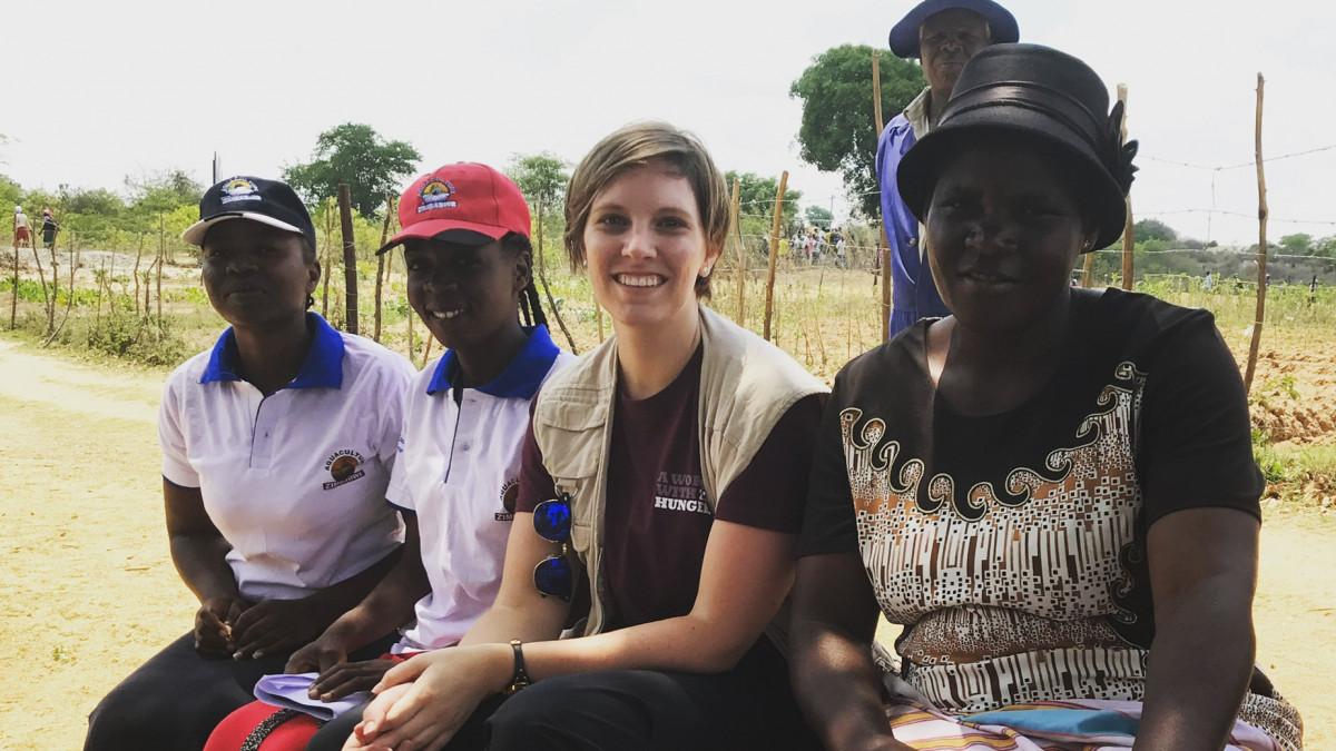 Ashley Baxstrom '07 with residents of Zimbabwe