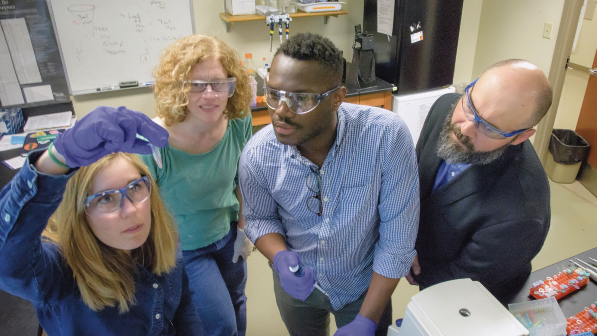 Sharon Crary works with students in the lab