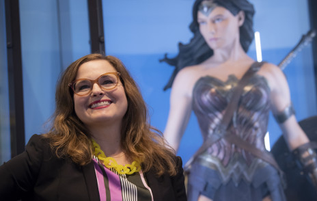 Jennifer Pace Robinson '92 stands in front of Wonder Woman costume.