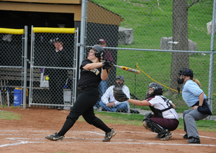 A home run in the making during DePauw's playoff softball game.